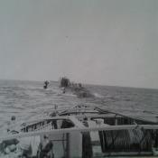 050. Лодка в районе Ньюфаундленда намотала на винт подводный кабель. Взяли на буксир, тащим в бухту Нипе, потом на банку Хагуа.