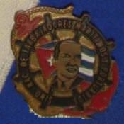Значок Национального профсоюза морских и портовых рабочих (Sindicato Nacional de Trabajadores Marítimos y Portuarios).
