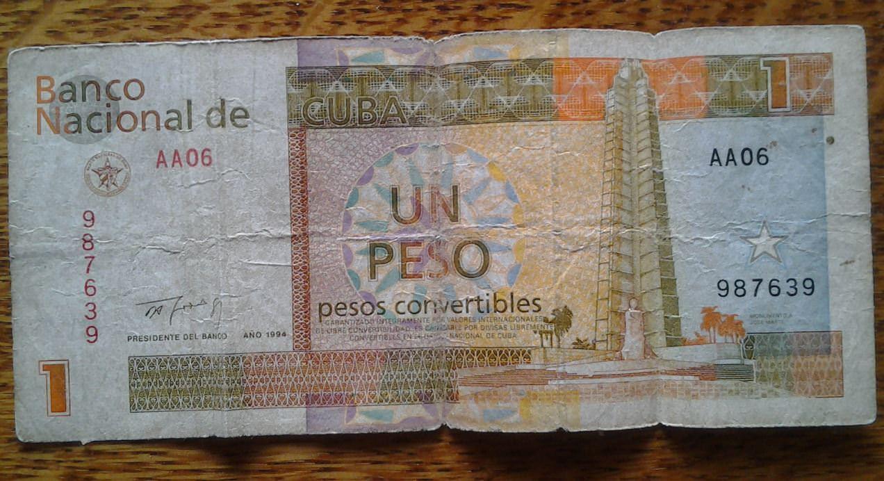 406. Купюра номиналом в 1 песо 90-х годов. Титул.